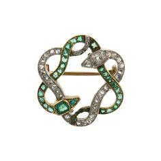 Belle Époque Diamond and Emerald Circular Serpent Pin; French, circa 1900