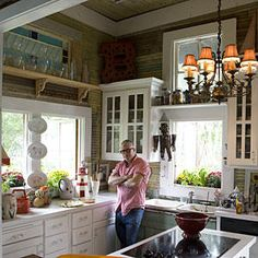 Personalized Taste - 110 Beautiful Kitchens - Southernliving. From the salvage wood walls to the bevy of vintage trinkets, this kitchen has big personality.