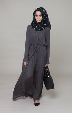 I love the fact that this is a jumpsuit yet its so modest and elegant. Totally love