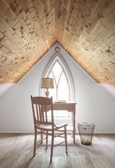 Cathy cleaned out a storage space with a cedar ceiling to create this quiet writing nook. The antique chair is from Something Simple, a shop in town. - CountryLiving.com