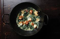North Indian saag paneer—meltingly soft spinach strewn with chunks of fresh cheese—is amazing especially when scooped up with hot flatbread.