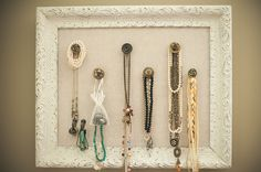 vintage inspired jewelry organizer made from an old frame, cabinet knobs and hooks, white matte spray paint & linen cute idea