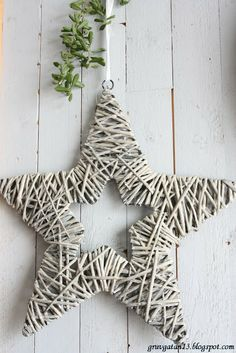 Star wire frame wrapped in straw and painted soft gray.