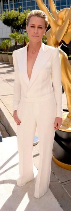At the Emmy Awards tonight, Robin Wright proved she can do no wrong on the red carpet. The actress looks unbelievable in a white custom Ralph Lauren tuxedo jumpsuit. An easy contender for one of the best dressed of the night. Robin Wright, Elie Saab Gowns, Winter Wedding Guests, The Emmys, Red Carpet Ready, Old Actress, Style And Grace, Fashion Wear, Nice Dresses