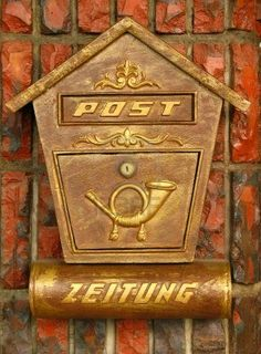 old-style-mailbox--the-german-word---zeitung--at-the-bottom-means-newspaper