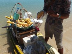 They arrive on their tiny boats filled with exotic fruits, chicken, fish coconuts and more, lunch on the beach everyday was great