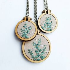 Restocked a few eucalyptus pendants! And waiting on a special delivery so I can make more. If you are interested in a custom pendant please… Embroidery Hoop Crafts, Modern Embroidery, Embroidery Jewelry, Ribbon Embroidery, Embroidery Thread, Cross Stitch Embroidery, Embroidery Designs, Bordados E Cia, Fabric Art