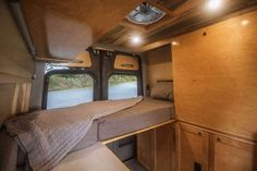 This van conversion was built for taking extended weekend trips, with a double drop down bed, large kitchen galley, and a modular bench seat with a dog bed. Van Conversion Plans, Van Conversion Interior, Camper Van Conversion Diy, Motorhome, Camper Beds, Diy Camper, Tiny House Big Living, Small Living, Converted Vans