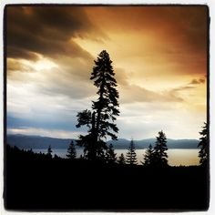 View of Lake Tahoe during a thunderstorm at sunset.