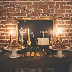 """A """"Mr."""" and """"Mr."""" donut bar with hanging lights, candles, and cityscape chalkboard art."""