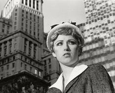 Cindy Sherman. Untitled Film Still #21. 1978. Gelatin silver print. 7 1/2 x 9 1/2 (19.1 x 24.1 cm) The Museum of Modern Art, New York. Horace W. Goldsmith Fund through Robert B. Menschel  One of the most often reproduced images of the series, this photograph is shot near 26 Broadway, originally the Standard Oil Building, in the Financial District (left). The modern glass building on the right at 2 Broadway was originally built in 1958-1959.