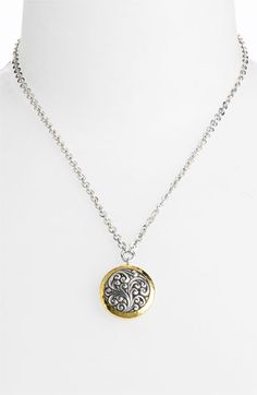 Lois Hill two tone circle pendant...own the ring in this collection