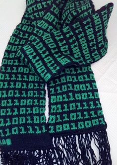 """Free Knitting Pattern for Binary Scarf - For the tech lover, this scarf incorporates binary code into stranded colorwork knit as as a tube so the reverse is hidden. You can knit random 1s and 0s or use a binary translator to create a message for your scarf like """"I love you"""" or the recipient's name. Ravelrers have adapted this pattern to hats, mitts, cowls, baby clothes, and more. Designed by Christine Dumoulin Pictured project by Neetstoo who knit the names of her family in binary"""