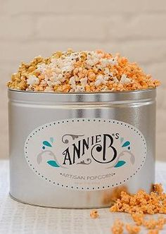 Gift gracious hosts this holiday season with the Annie B's Three-Flavor Artisan Popcorn Tin that's sure to thrill with it's delicious flavors and sleek tin.