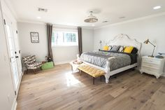 Open master bedroom with natural oak flooring - as featured on 'Rafterhouse' pilot episode on HGTV.