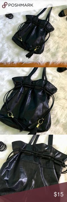 Mark black drawstring tote Black tote bag. Drawstrings have gold accents tighten.  Excellent used condition Mark by Avon Bags Shoulder Bags