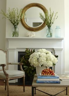 Simple and beautiful!  small chair, bouquet of flowers, circular mirror on mantle...doable.