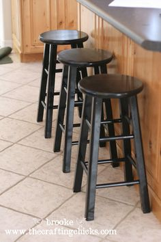 Spray painted stools - DIY instructions at http://thecraftingchicks.com/2010/07/mod-podge-fabric-beautiful-barstools.html