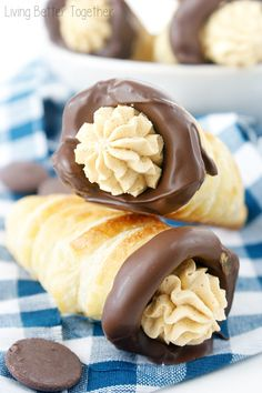Pumpkin Chocolate Cream Horns - A buttery and flaky pastry horn filled with sweet pumpkin cream and dipped in dark chocolate.