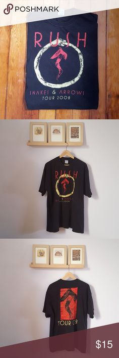 """Rush Snakes & Arrow Tour 2008 t-shirt Rush Snakes & Arrow Tour 2008 t-shirt. 100% cotton, made in Mexico. Black t-shirt with red and yellow graphic. Marked a size XL- 23"""" armpit to armpit, 29"""" long. In good condition with some color fade and a very small hole next to the graphic. #rush #band #tour #bandtshirt #tourshirt #2008 Shirts Tees - Short Sleeve"""