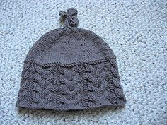 Ravelry: Reverse Cable Rib Baby Hat pattern by Adrienne Medrano