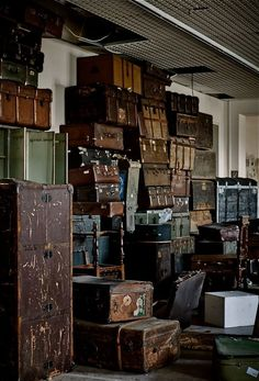 A collection of vintage trunks and suitcases.
