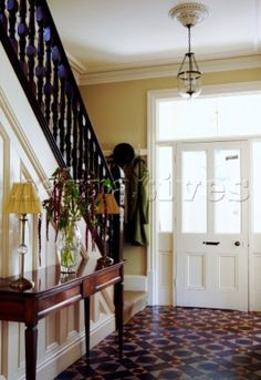 Wooden banister in tiled hallway of Birmingham townhouse