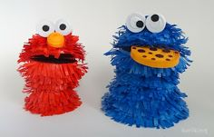 Cookie monster and Elmo made from paper using 3D paper quilling techniques