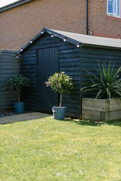 Garden Shed In A New Build Garden Painted Dark Grey And Decorated With Monochrome Festoon Lights - Image By Adam Crohill shed design shed diy shed ideas shed organization shed plans Bog Garden, Garden Cottage, Shade Garden, Quick Garden, Garden Kids, Painted Garden Sheds, Painted Shed, Garden Sheds Uk, Painted Garden Furniture