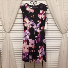 Floral watercolor dress Medium length floral watercolor dress soft with beautiful pink zipper detail. Would be great for office church or date night out. Pair with a blazer or a bright pair of pumps to finish the look. Maggy London Dresses Midi