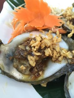 Rawai beach phuket, Rawai, Thailand - Oysters fried with garlic