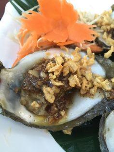 Rawai beach phuket, Rawai, Thailand - Oysters fried with garlic