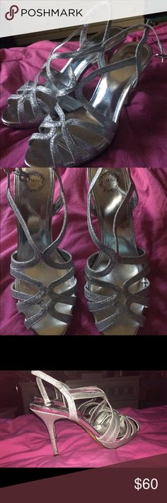 High heels Like new. Never worn. I can't walk very well in high heels so need to sell them. But very cute. Silver and glittery. Size 10 women's bought them from JcPenny's jcpenney Shoes Heels