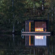 This floating sauna, with a blackened-wood exterior, is nestled in a Swedish forest. See our round up of blackened-wood architecture on…
