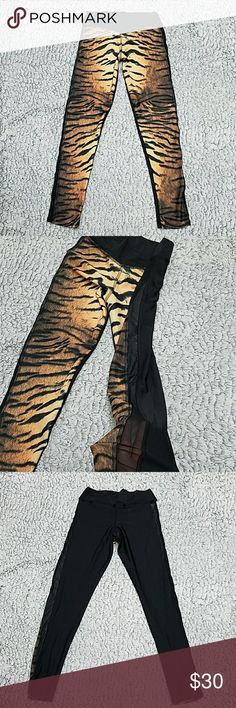 Abs2b tiger mesh leggings Like new just tried on. I purchased for the gym but MY hubby won't let me wear them to the gym. Haves mesh that runs all the way up the sides. Tiger print in front and all black on the back side great high quality feel.  CHECK OUT MY OTHER LISTINGS ON MORE AMAZING DEALS abs2b Pants Leggings