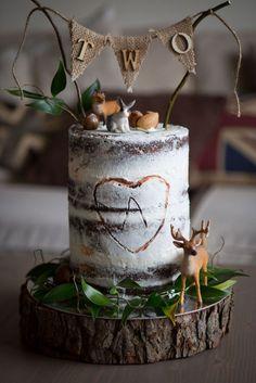 Cake by www.frenchmade.co.uk #birthdaycake #chocolate #celebration #cake #birthday #seminakedcake #woodland #foliage #hessianbunting #burlap #birthdayboy #twigs #wood #log #forest #deer