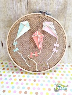 Give this easy and inexpensive spring craft a try. With just a few inexpensive materials, you can make this darling cottage style hoop art.