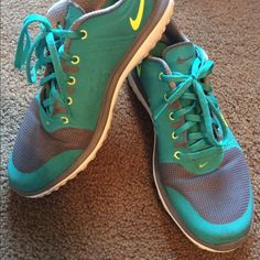 Nike sneakers! Fab color!  Nike fit soles! Deep turquoise with florescent yellow and grey highlights. Gently loved. Dirt shown on front of sneakers in pictures. NO trades. No lowballs. Thanks for shopping. Nike Shoes Athletic Shoes