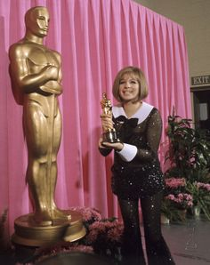 April 14, 1969 — At the 41st Academy Awards, Barbra Streisand wins the Best Actress Oscar for Funny Girl (1968), wearing Arnold Scassi