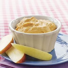 My favorite pumpkin dip - cooking light      3/4 cup (6 ounces) 1/3-less-fat cream cheese      1/2 cup packed brown sugar      1/2 cup canned pumpkin        2 teaspoons maple syrup      1/2 teaspoon ground cinnamon      24 apple slices