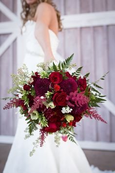 The shades of red and maroon and collection of textures made the bride's bouquet nothing short of perfect. |||includes: dahlias, roses, astilbe, phlox, seeded eucalyptus