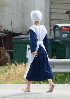 Amish girl walkilng barefoot