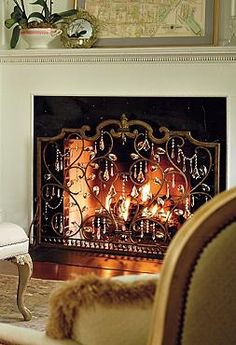 Beautifully guard your home and guests from errant sparks and flames with the Louviere Fire Screen that will also add character to your hearth.