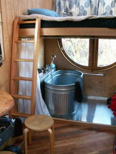 Tiny home. I like the tub! Good use of space, keeping it open.