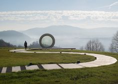 Sitting atop Čukur hill in Banovina, Croatia is a sculpture of a giant camera lens. Its clean, circular form is nearly flawless, but it has one subtle imperfection—there is a single bullet hole that fractures the crystal-clear glass. This crack is intentional, and its significance honors a fallen Croatian photographer named Gordan Lederer who lost his life in 1991. As he was standing on Čukur hill documenting the Croatian War of Independence, he was tragically shot and killed by a sniper…