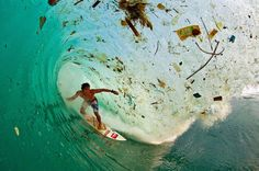 """Surfer Dede Surinaya riding a wave in a remote but garbege-covered bay on Java, Indonesia, the world's most populated island """" Water and air, the two essential fluids on which all life depends on have become global garbage cans"""" Jacques-Yves Cousteau Ocean Pollution, Environmental Pollution, Plastic Pollution, Environmental Posters, Environmental Issues, Environmental Degradation, Environmental Education, Our Planet, Our World"""