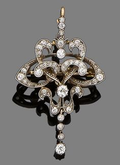 A diamond brooch/pendant, circa 1910  The openwork cartouche set throughout with old brilliant and rose-cut diamonds, suspending a knife-edge bar collet-set with old brilliant-cut diamonds, diamonds approx. 0.80ct total, detachable brooch fitting, length 3.4cm