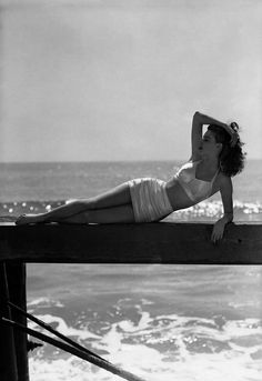 Ava Gardner. Should I ever have a reason to get a bathing suit in my life again, which is doubtful, I'd want one like this.