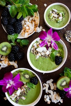This tropical green smoothie bowl is made with frozen bananas mango kiwi mint spinach chia seeds vanilla soy yogurt and coconut milk. Healthy Green Smoothies, Fruit Smoothies, Smoothie Bowl Green, Cleanse Recipes, Smoothie Recipes, Healthy Breakfast Recipes, Healthy Recipes, Brunch Recipes, Delicious Recipes
