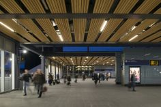 Hunter Douglas Solid Wood Linear Open System, finished in Siberian Larch was specified for Reading railway station. #hunter douglas #ceilings #transport #reading #arcitecture